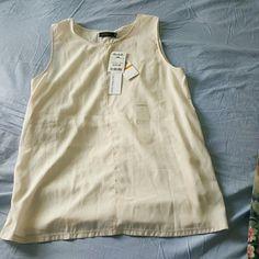 Creamy cream Sleeveless top Goes great under a blazer. Brand new Calvin Klein Tops Tank Tops