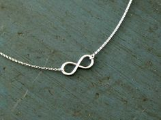 Sterling Silver Infinity Necklace Simple Minimalist Jewelry Designer Inspired Bridesmaid jewelry. $20.50, via Etsy.