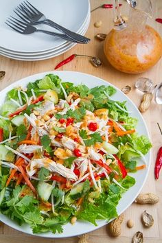 Sweet Chili Chicken Salad -- chicken, lettuce, bean sprouts, red pepper, carrot, cucumber, green onions, scilantro, mint, basil, chilies, peanuts, sweet chili dressing