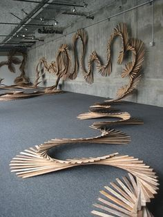 Wood Sculpture Inspiration- possibly have a transition from orderly flat wood to rounded dowels...to natural wood