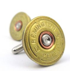 shotgun shell cufflinks  Oh wow...I like these a lot, even though women don't typically have shirts which require cuff links.