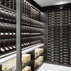 bespoke home wine cellar with wood and marble serving shelf