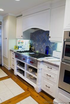 Traditional Two-Tone Kitchen Cabinets #15 (Kitchen-Design-Ideas.org)  Open cabinets under cook top for pans- pots.