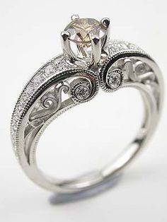 Kind of like the idea of a vintage or antique engagement ring :Contemporary Champagne Diamond Engagement Ring....except a much bigger diamond! Lol
