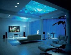A fish tank suspended in the ceiling of this home creates an underwater feeling.