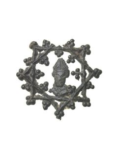 Pilgrim badge from the shrine of St Thomas Becket at Canterbury Cathedral. This badge is in the form of a mitred head within a pentacle covered with pearled trefoils. The head is a depiction of the head-shaped reliquary bust that held the remains of Thomas Becket's skull. 14th century | Museum of London