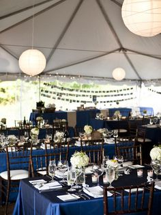 cute table settings. you should look at the rest of her pictures too because her colors were navy and yellow.
