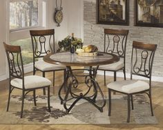 """With the flowing beauty of the welded steel frame covered in an aged bronze color powder coat finish supporting a rich medium brown wood finished table top accented by a high gloss polyurethane faux marble inset, the """"Hopstand"""" dining collection flawlessly captures the artistic feel of inviting contemporary style."""