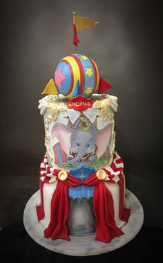 This cake was handpainted and airbrushed. Dumbo is handpainted as is the entrance to the tent. The ball was made of Daisy Paste. The rest of the cake is from bakels pettinice Dumbo Birthday Party, Circus Birthday, Birthday Cake, Birthday Ideas, Dumbo Cake, Dumbo Baby Shower, Carnival Baby Showers, Circus 1st Birthdays, Circus Cakes