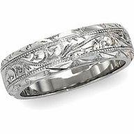 white gold, diamond, and sapphire wedding band.