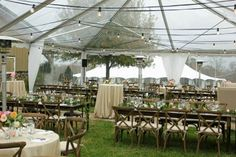 Clear Top Tent Wedding in Georgia with Crossback Chairs and Farm Tables - Georgia Wedding Venues
