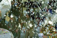Confetti raining down on Tschaggatta Carnival parade in Lotschental Valley, Switzerland