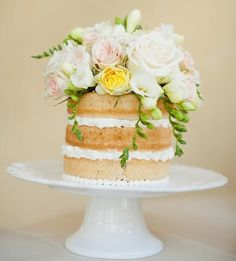 this rustic cake is amazing! you could be resourceful and put your own real flowers on it!