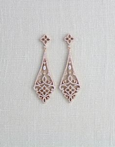 Beautifully crafted Rose Gold bridal earrings glitter beautifully with Art deco style design in clear Swarovski Pure Brilliance Zircons. Personally designed and created by me. Earrings measure: 2.5 from post to bottom of earrings and are 7/8 at their widest. Very light in weight and