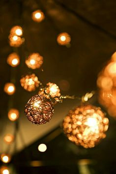 Add a little flair to classic strings lights with twine balls. #lightingdesign
