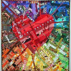 This stunning modern quilted wall hanging is constructed of many small pieces of fabric from each color of the rainbow.The Amazing Technicolor Dream Heart–ROYGBIV Entry