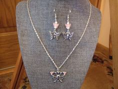 Pink crystal butterfly necklace with matching shepherd hook earrings