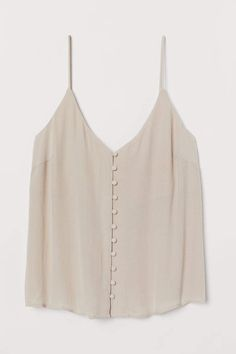 Sleeveless top in airy, jacquard weave viscose with a V-neck, narrow shoulder straps and covered buttons at the front. Teen Fashion, Fashion Art, Fashion Outfits, Paperbag Hose, Bodycon, Fashion Company, Swagg, V Neck Tops, Neue Trends