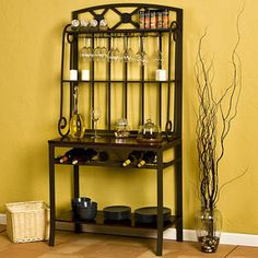 @Overstock.com - Decorative Bakers/ Wine Storage Rack - Create a chic Tuscan feel to your kitchen or dining room with a mahogany bakers rack and wine rack. The bottom shelf sits near the floor, the top shelf of the rack holds wine glasses, and the main work surface stores wine bottles just beneath.     http://www.overstock.com/Home-Garden/Decorative-Bakers-Wine-Storage-Rack/2683393/product.html?CID=214117  $240.99