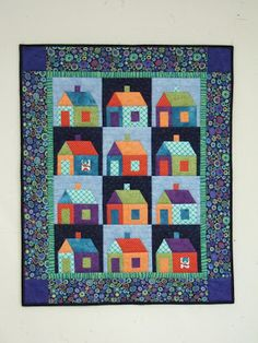 http://gladcreationsquilts.blogspot.com/2012/03/national-quilting-day.html  Good Neighbors, using Marti Mitchell's small house template set ; Clm: love the colors together