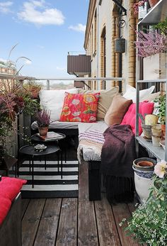 Bench/banquette seating is generally a much more space-efficient choice for a small balcony or outdoor space. And frankly, is way more cozy than one of those teeny metal bistro sets!