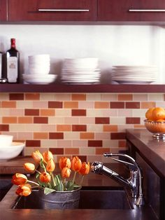 Tile Your Backsplash - I love a ledge. Our kitchen is very small, so all our storage needs to go up. I have cup hooks as a border along one wall for a 3D effect. This is nice.