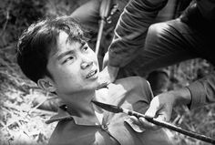 With the persuasion of a Viet Cong-made spear pressed against his throat, a captured Viet Cong guerrilla decided to talk to interrogators, telling them of a cache of Chinese grenades on March 28, 1965. He was captured with 13 other guerrillas and 17 suspects when two Vietnamese battalions overran a Viet Cong camp about 15 miles southwest of Da Nang air base.