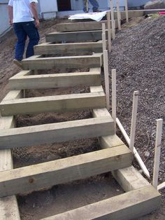 And another photo of timber steps...would be good for a hillside garden too if you double the front, so you could walk on it.