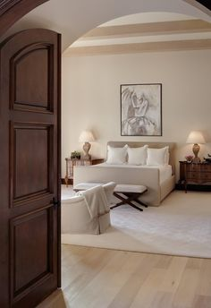 Doors and arched entrance way.  Bed frame is a little underrated given the size of the room