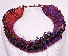 Argentina-born Luis Acosta's paper jewelry necklace