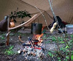 Nice camp with soup and bread on the fire