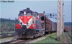 The Chicago, Rock Island and Pacific Railroad  Showing off the Rock Island's original livery of red, crimson, and white is GP7 #1298 as it pulls a cut of cars through the yard and past Oakland Tower in St. Paul, Minnesota on June 4, 1964.
