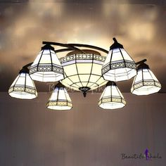 """$290  39"""" http://www.beautifulhalo.com/vintage-swirly-blue-stained-glass-tiffany-8light-chandelier-with-center-bowl-p-241284.html?currency1=USD"""