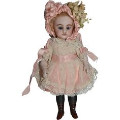 Here we have a very HIGHT QUALITY All Bisque doll by Simon and Halbig, She has lovely blue glass sleep eyes ( not perfect), well painted lashes and