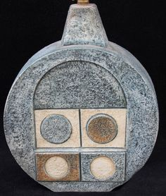 A Troika pottery wheel lamp base, having relief and incised decoration of stylised motifs on a blue ground, signed and with painted initials for Penny Black, height excluding fitting click now for info. Ceramic Pottery, Ceramic Art, Painted Initials, Pottery Marks, Pottery Wheel, St Ives, Antique Auctions, Ceramic Design, Contemporary Ceramics