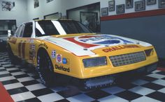 DW's 1983 Pepsi Challenger Monte Carlo SS at Darrell Waltrip Motorsport's shop in Never could figure out what a yellow & red car had in common with Pepsi.Love these old Monte SSs though. Nascar Costume, Slot Car Sets, Jeff Gordon Nascar, Nascar Race Cars, Mario Andretti, Custom Muscle Cars, Pepsi, Monte Carlo