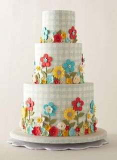 Gingham and colorful flowers are perfect for a picnic weddings weddingcake