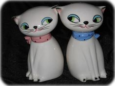 "Cozy Kittens Large-eyed Salt and Pepper Shakers with a noise mechanism that will ""meow"" when turned upside down. Pretty rare to find a set that still works. 1958"
