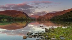 'When The Red Dragon Stirs...' Llyn Nantlle, Snowdonia.The Snowdonian peaks bathed in red this evening looking up the Nantlle valley towards Snowdon. Nantlle, Wales, United Kingdom.