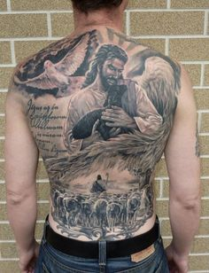 Full back tatoo of Jesus and a lamb