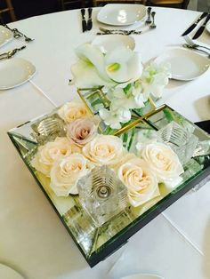 Simple elegant Floral Centrepiece by DT Floral & Decor #weddingflowers #weddingcentrepiece #torontoflorist #torontoweddingflorist #flowers #roses #orchids #eventflorist #centrepieceidea #glassvotives #glasstray #centrepiece #design #florist #yyz
