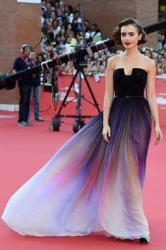 Lily Collins looking UNREAL at Rome Film Festival | http://www.cosmopolitan.co.uk/fashion/celebrity/news/a30568/lily-collins-purple-gown-rome-festival/