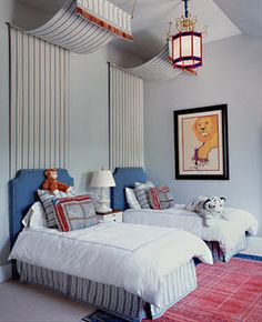 love the idea of using the draped fabric to add height to the headboard.