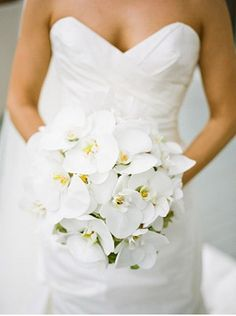 Beach wedding ideas: A beautiful bridal bouquet made of white orchids is perfect for a beach themed wedding #Celebstylewed