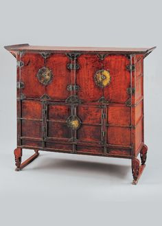 This is a clothing chest from the late 18th century. It is from Korea. Its simplicity of four squares allows for the elaborate nature of the hinges, and the color of wood brings a quality of wealth and aristocracy.