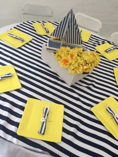 Centerpieces. Yellow flower box with a boat. Nautical baby girl shower! Yellow, Navy blue and white.
