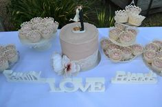 Wedding cake and cupcakes by Kayla Moir