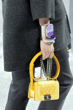 Chanel 2012.  Purple and Yellow. Look at how cute that handbag is!
