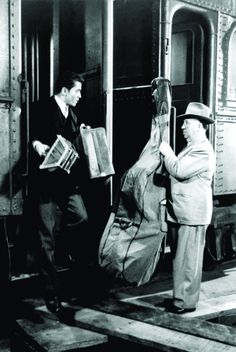"""Alfred Hitchcock's cameo in """"Strangers on a Train"""", (1951) with Farley Granger."""