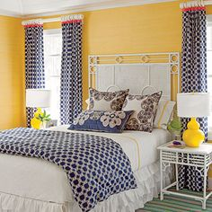These cheerful yellow walls are covered in wallpaper from Phillip Jeffries Ltd. - White/Blue/Yellow bedroom